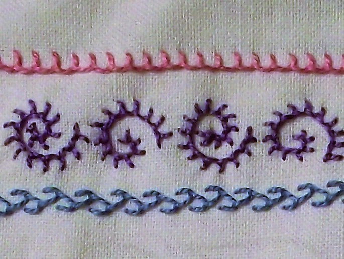 Dorset Feather Stitchery worked sample close up